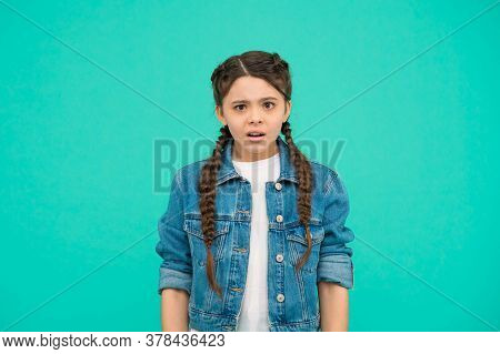What. Confused Girl Blue Background. Beauty Look Of Child Girl. Little Kid In Casual Style. Fashion