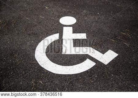 Disabled Sign On The Asphalt