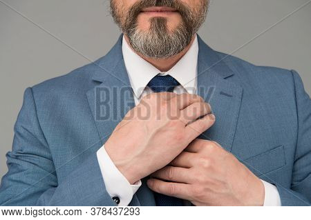 Hands Tying Tie Formal Suit Fashionable Blazer Close Up, Male Accessory Concept.