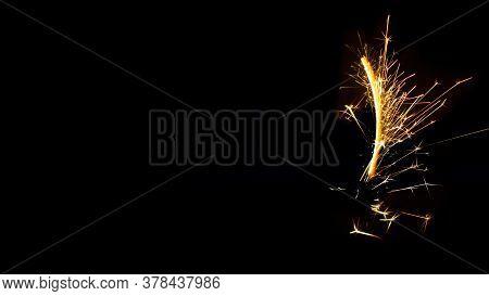 Sparks Of Sparkler On A Black Background.