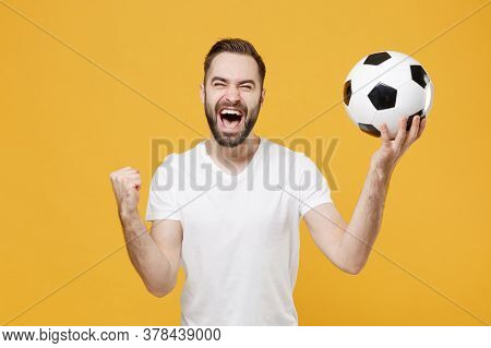 Happy Young Bearded Guy Football Fan In White T-shirt Isolated On Yellow Background Studio. People S