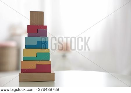 Colorful Wooden Blocks On White Table In Room. Space For Text