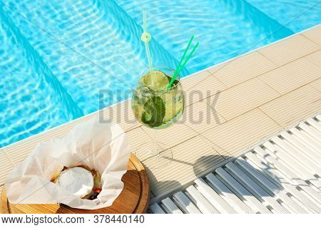 Glass Of Delicious Mojito And Brie Cheese Near Swimming Pool. Refreshing Drink