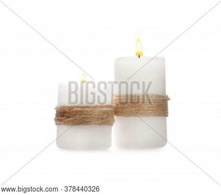 Wax Candles Decorated With Twine Isolated On White