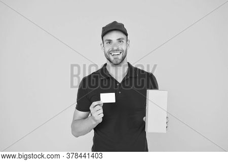 Glad To Serve. Unique Offer. Man Red Cap Yellow Background. Delivering Purchase. Delivered To Your D