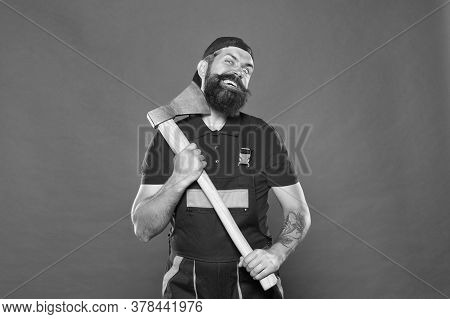 Going Crazy Male. Concept Of Hairdressing. Handsome Happy Man With Axe. Making His Beard Shape. Agri