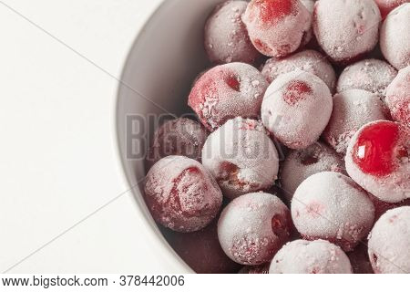 Close-up Of Frozen Cherries On A Plate.