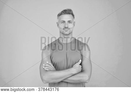 Confident In His Strength. Confident Look Of Muscular Guy. Confident Man Keep Arms Crossed Blue Back