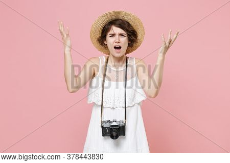 Irritated Young Tourist Woman In Dress Hat With Photo Camera Isolated On Pink Background Studio Port