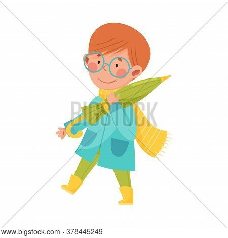 Smiling Boy Character In Rubber Boots And Raincoat Walking And Carrying Umbrella Vector Illustration