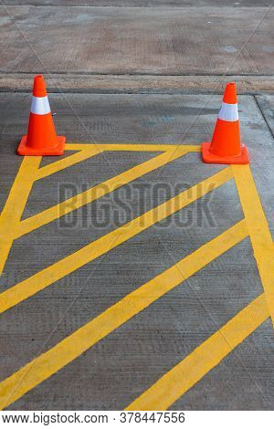 Parking Lot With Traffic Cone On Street Used Warning Sign On Road. Traffic Warning Cone In Row To Se