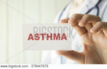 Doctor Holding A Card With Text Asthma, Medical Concept