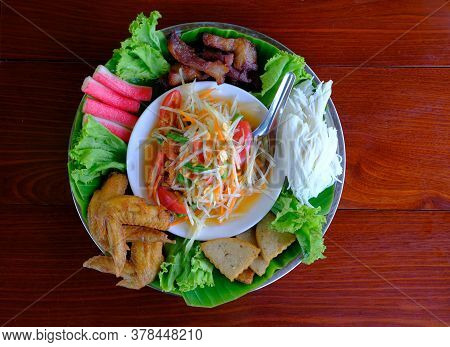 Papaya Salad Or Som Tum In Thai, On Tray With Side Dish Set, Chicken Fried, Rice Noodles, Roasted St