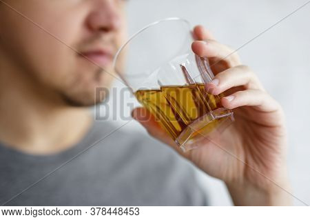 Close Up Of Young Man Drinking Whiskey Or Brandy