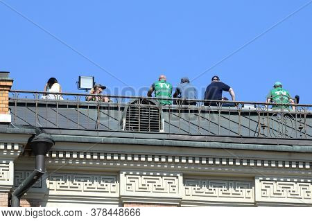 Moscow, Russia - June 24, 2020: Journalists On The Roof Of The Moscow Hotel