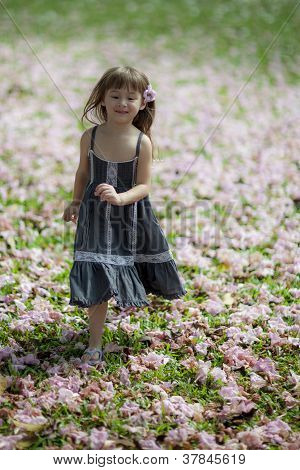 young girl running amongst flowers