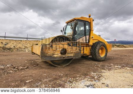 Yellow Steamroller Performing Ground Leveling Work In Spain