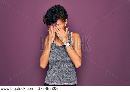 Young beautiful african american afro sportswoman doing exercise wearing sportswear rubbing eyes for fatigue and headache, sleepy and tired expression. Vision problem