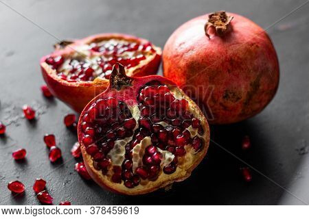 Fresh Ripe Pomegranate Fruit On A Black Background