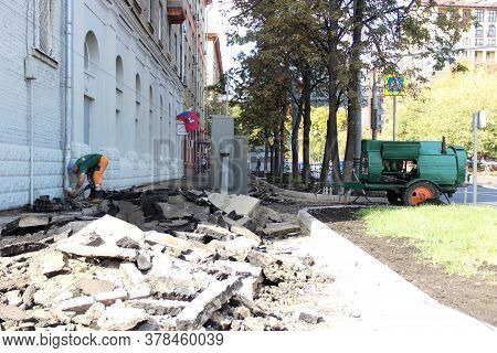Russia, Moscow - September 2019: Removal Of Asphalt Pavement For Subsequent Road Repair. The Pieces