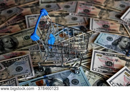 Empty Grocery Cart On The Background Of Dollar Bills, Crisis Concept, Inflation