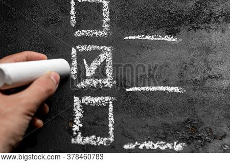 Hand Holds Chalk And Makes A Choice. Voting, Checklist, Option Selection