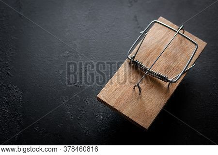 Wooden Mousetrap On A Black Background With Place For Text