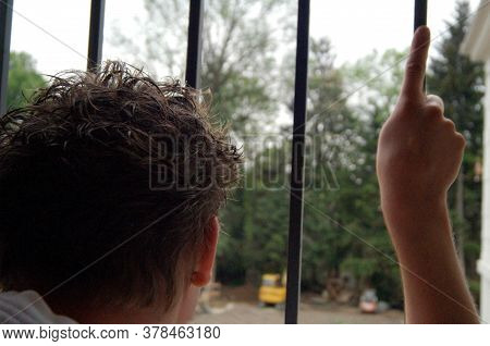 Behind Bars, Serve A Sentence In Imprisonment, Person Looks To The Outside Through The Bars