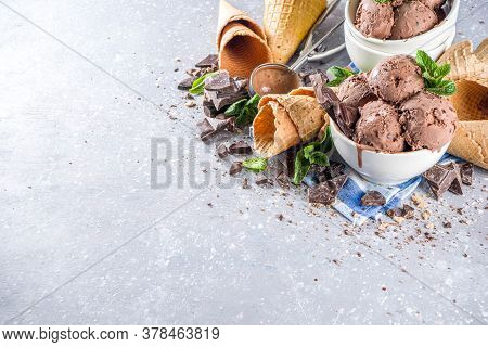 Homemade Chocolate Ice Cream With Chocolate Pieces And Shavings, And Ice Cream Cones. In Small White