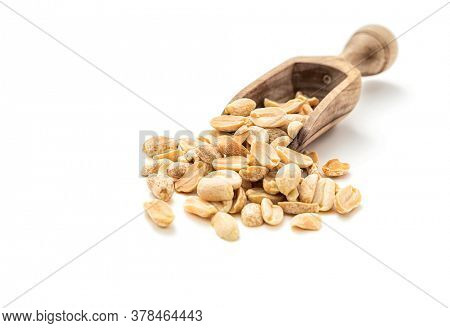 Marinated peanuts in wooden scoop on white background