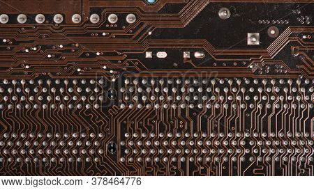 Modern printed brown circuit board, electronic circuit board, textolite. Background banner.