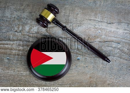 Wooden Judgement Or Auction Mallet With Of Jordan Flag. Conceptual Image.