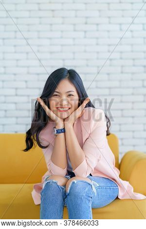 Asian Woman Smile Relaxing Sitting On Sofa At Living Room, Lifestyle Relax Concept.