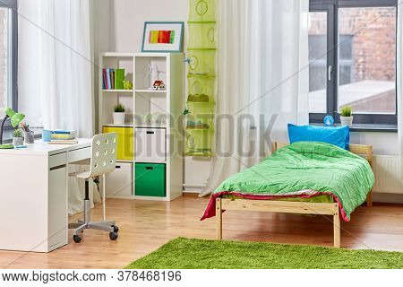 interior, home and furnishing concept - kid's room interior with bed, table and bookcase