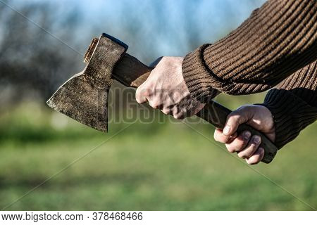 An Angry And Dangerous Man Holds An Ax In His Hands And Wants To Commit A Crime. Lumberjack With An