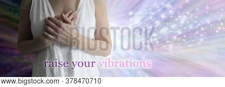 Raise Your Vibrations Healing Concept Banner - Female Torso In White Robes With Hands Laid Over Hear