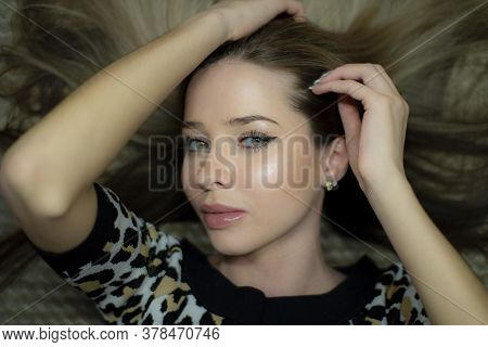 Portrait Of A Beautiful Young Blonde With Long Hair.