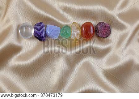 Single Row Of The Seven Chakra Healing Crystal - Magenta, Indigo, Blue, Green, Yellow, Orange And Re