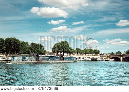 Riverside In Paris With Ferris Wheel On Concorde And Passenger Boat