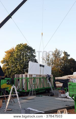Crane Lifting A Section Of A Prefabricated House