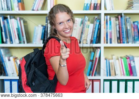 Smart German Female Student At Library Of University Looking At Camera
