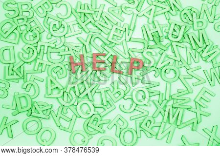 Help Needed With Word Blindness Dyslexia - Lime Green Alphabet Letters Randomly Scattered With Brown