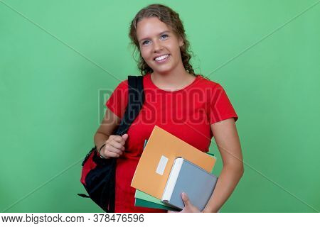 Beautiful German Female Student With Red Shirt Isolated On Green Background