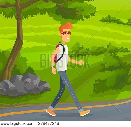 Young Red-haired Man In Glasses With Backpack Traveling Alone. Smiling Guy Walking At Road At Backgr
