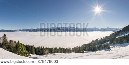 Fantastic Panoramic View Of Snow Mountains With Blue Sky And Sun. Great Panorama To Mountain Range A