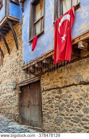 Cumalikizik village is a 700 years old Ottoman village in Turkey. Old Ottoman village in Bursa city, Turkey. Old Ottoman stone house with turkish flag
