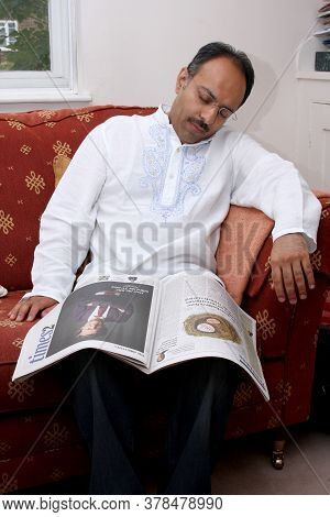 A Man Falls Asleep Whilst Reading His Paper, Taken In Witney, Oxfordshire In The Uk On The 27th Augu