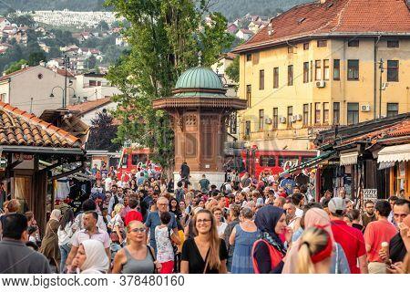 Sarajevo, BiH - August 29, 2019: Bascarsija square with Sebilj wooden fountain in Old Town Sarajevo in Bosnia and Herzegovina