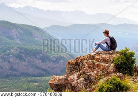 Hiker With Backpack Enjoying Valley View. Activity Leisure In Mountain.