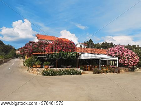 Traditional Croatian Restaurant Under Pink Oleanders In Vrboska On Hvar Island, Croatia